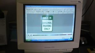 Sign Is Designed on the Computer and Sent to Cutting Machine